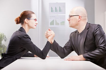 Giuliofornasar | Dreamstime.com - Woman Vs Man Business Arm Wrestling Photo
